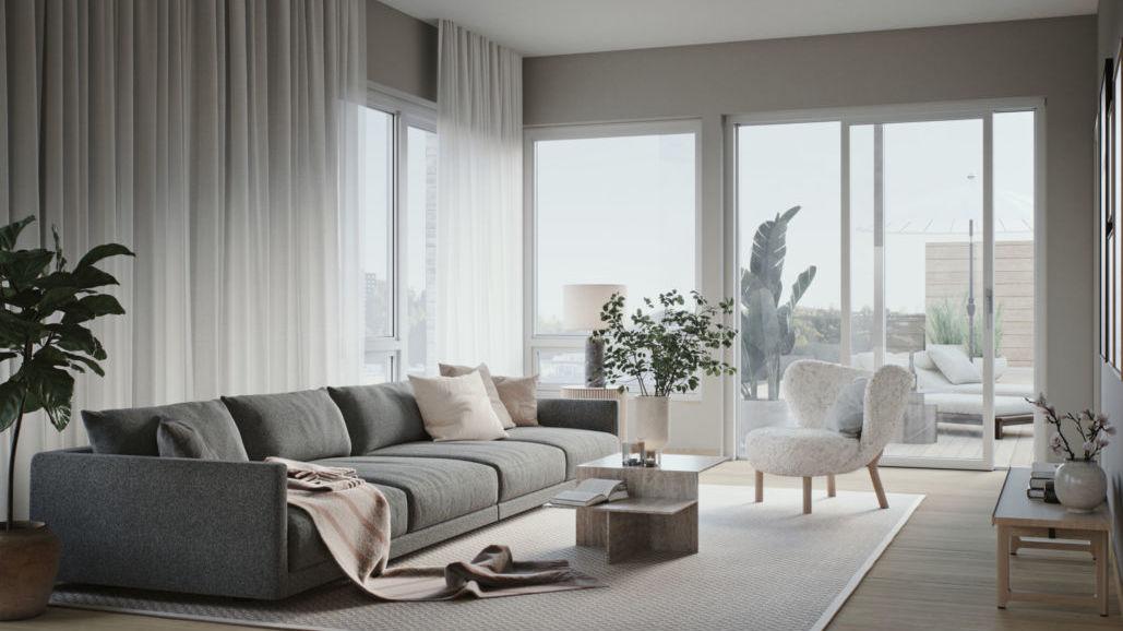 Lys og åpen stue med dirkete utgang til terrasse